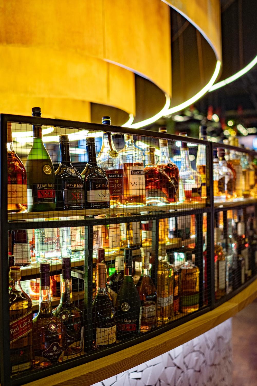 assorted wine bottles on racks indoors