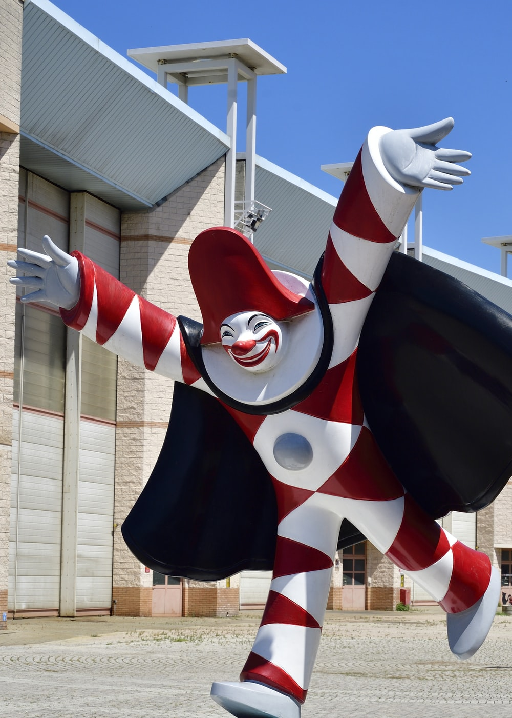 white, red, and black clown statue