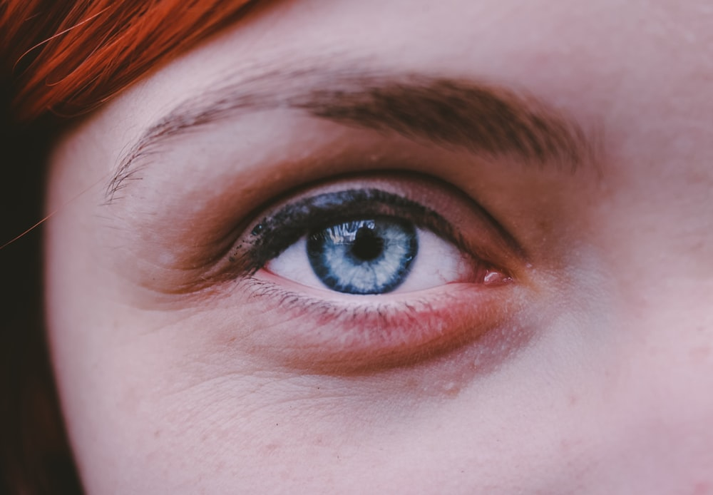 person took photo of blue eye