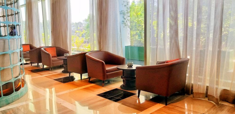 Amazing Empty Brown Leather Tub Chairs Photo Free Furniture Image Creativecarmelina Interior Chair Design Creativecarmelinacom