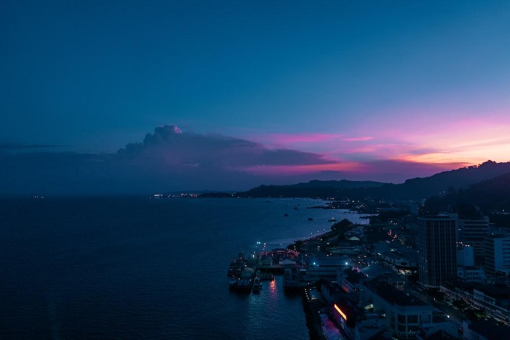cityscape facing ocean during golden hour