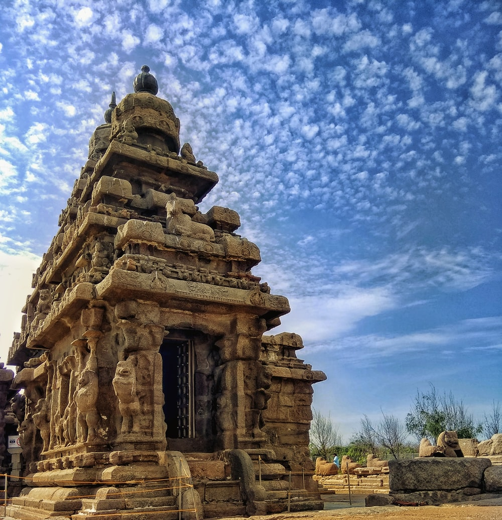 brown temple under blue and white skies