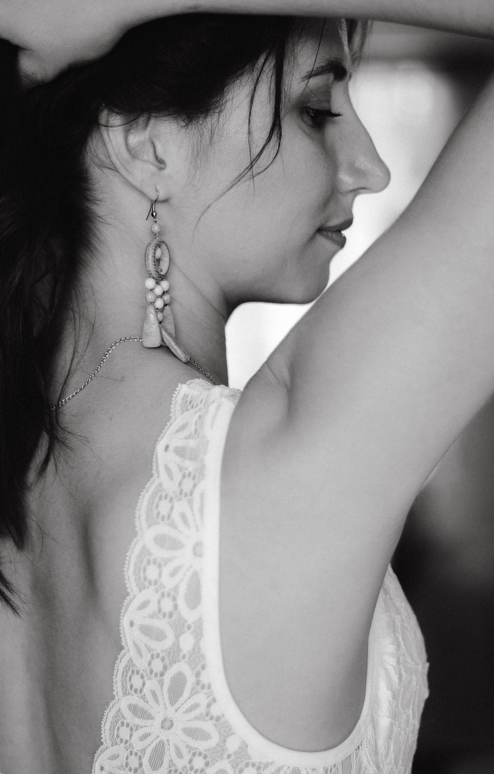 grayscale photography of woman wearing white top