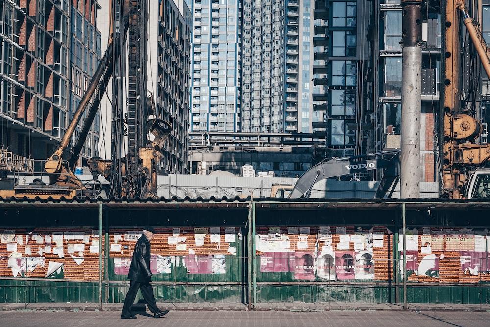 man walking on sidewalk during daytime