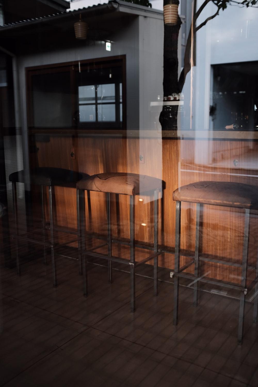 brown fabric and gray metal bar stools