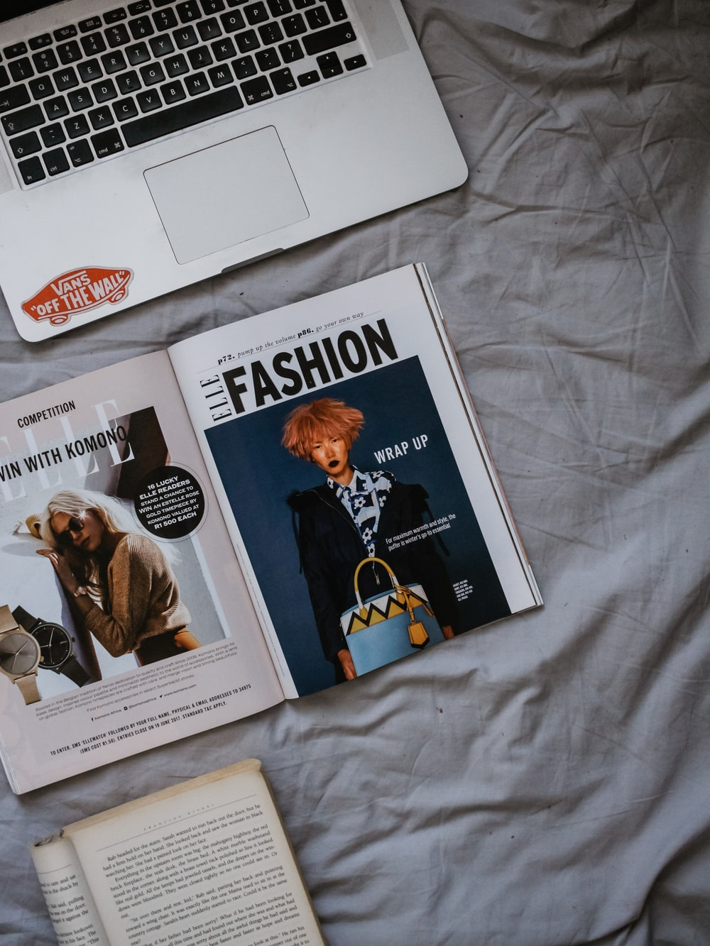MacBook Pro beside magazine