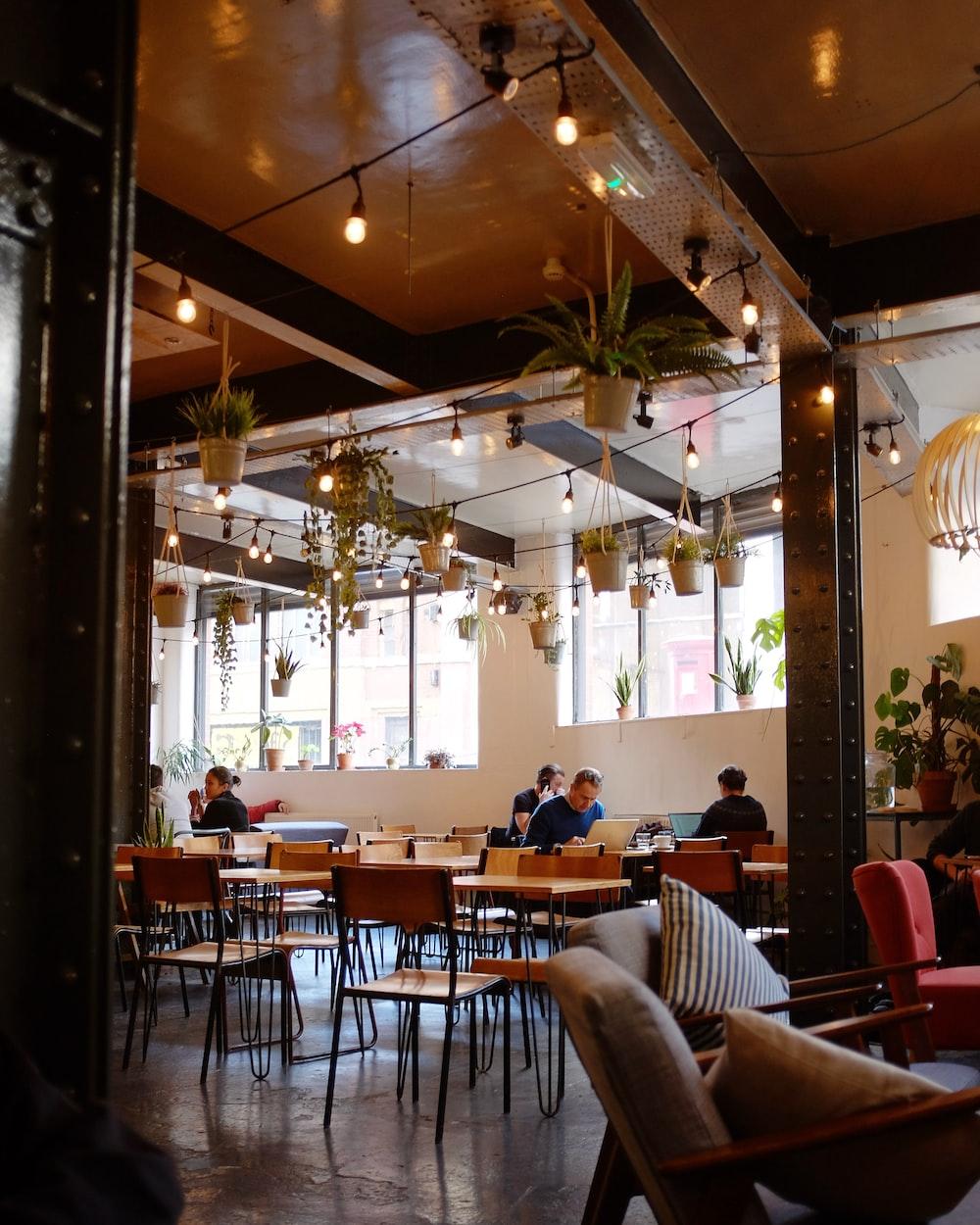 people inside restaurant during daytime