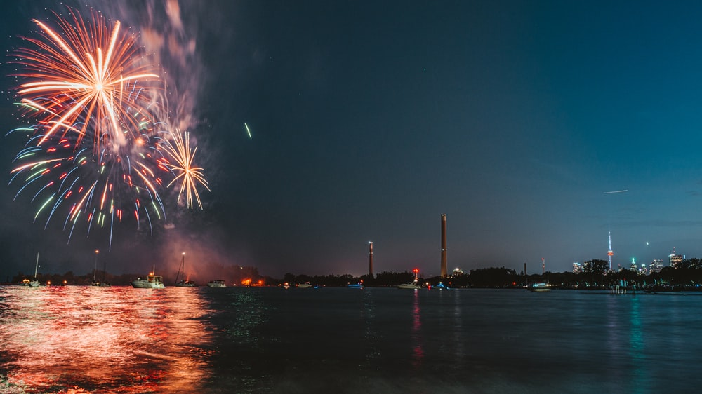 fireworks over sea during nighttime