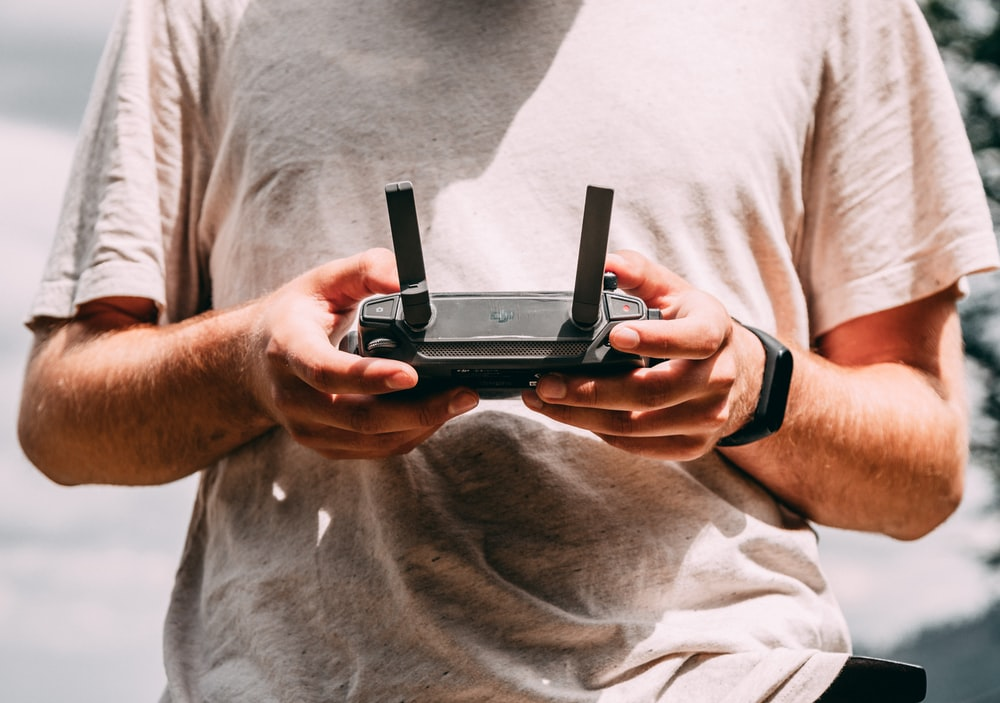 person holding black RC controller