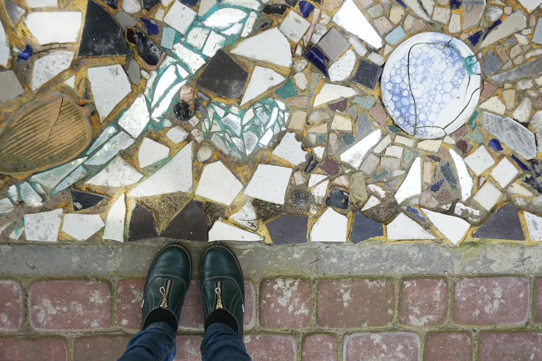 Broken ceramic fragments adorn the street of the old city. Look down.