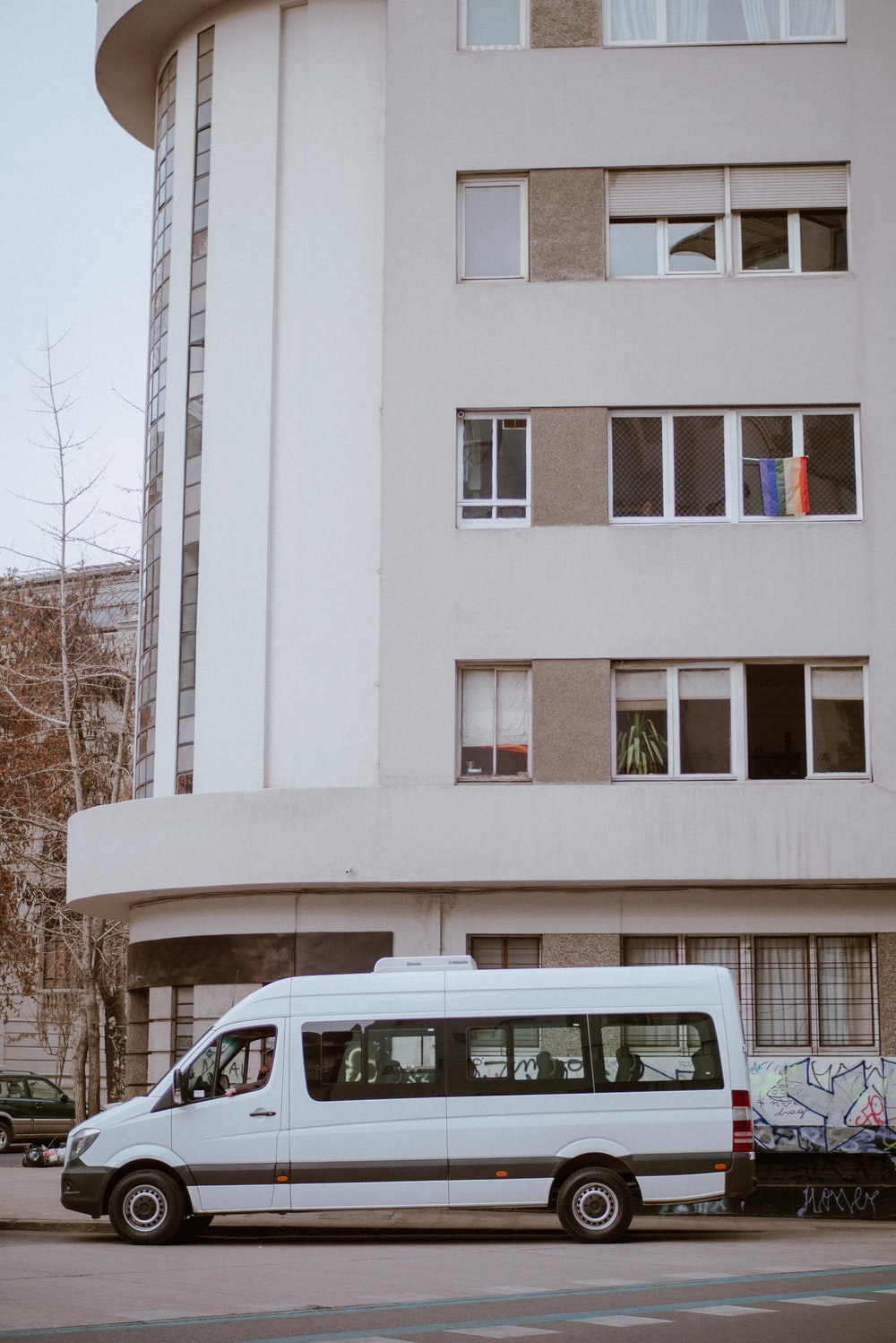 white van parking near building