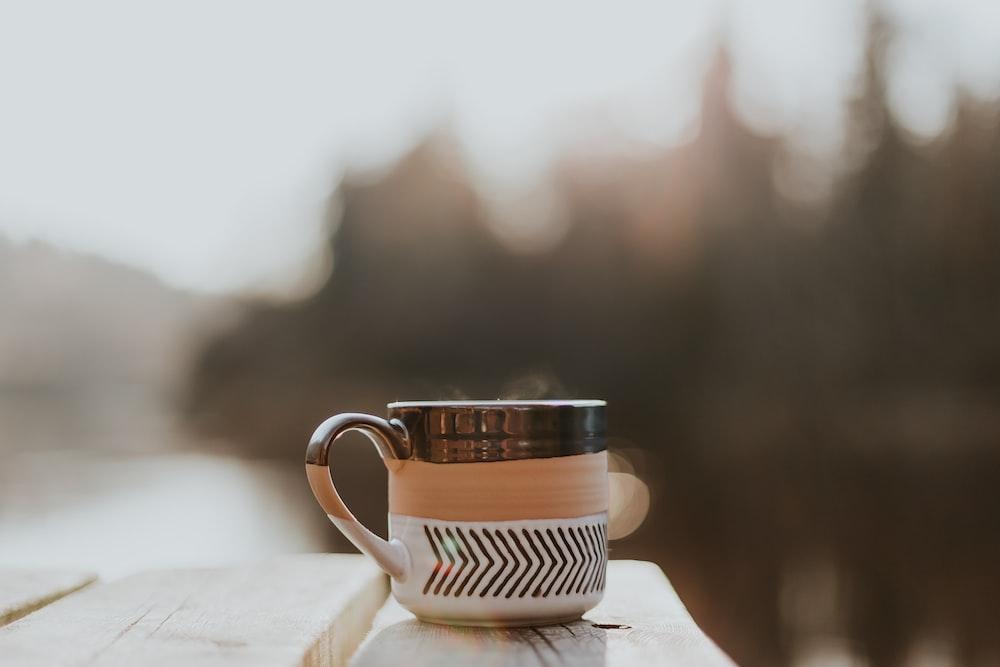 brown and white mug