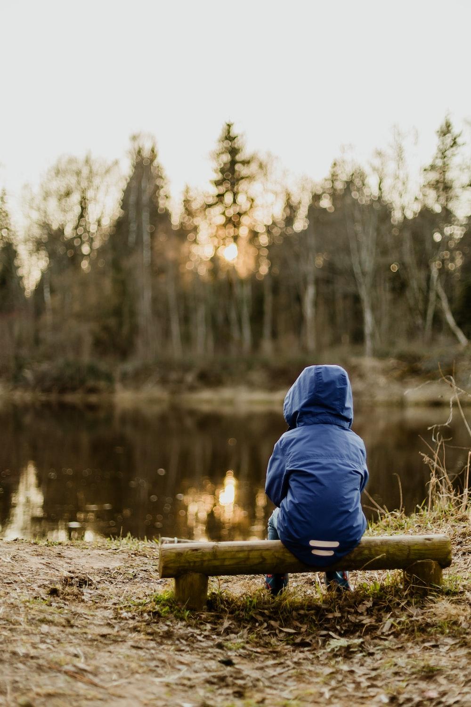 boy wearing blue hoodie