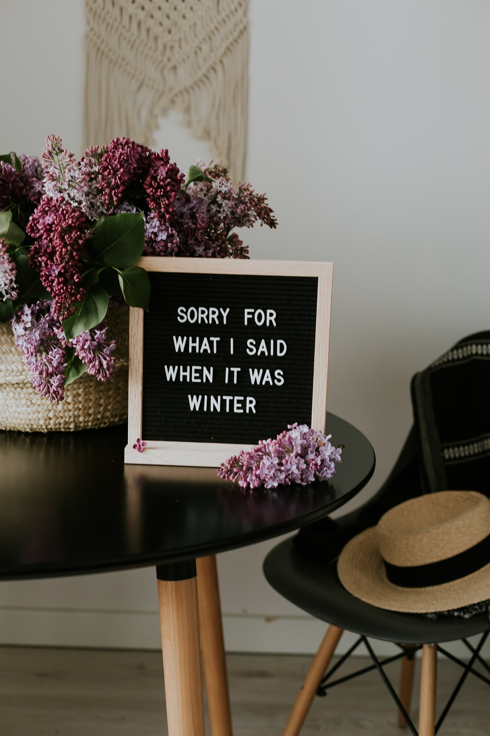 white and black board with sorry for what I said when it was winter beside