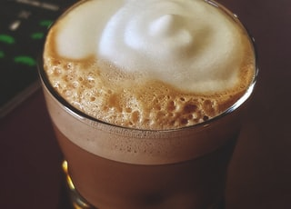 coffee with foam on glass cup