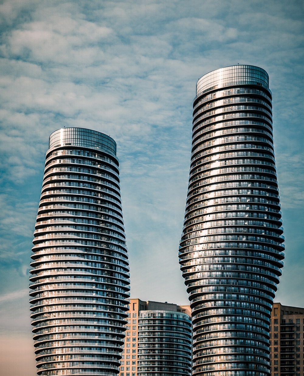two gray high-rise buildings