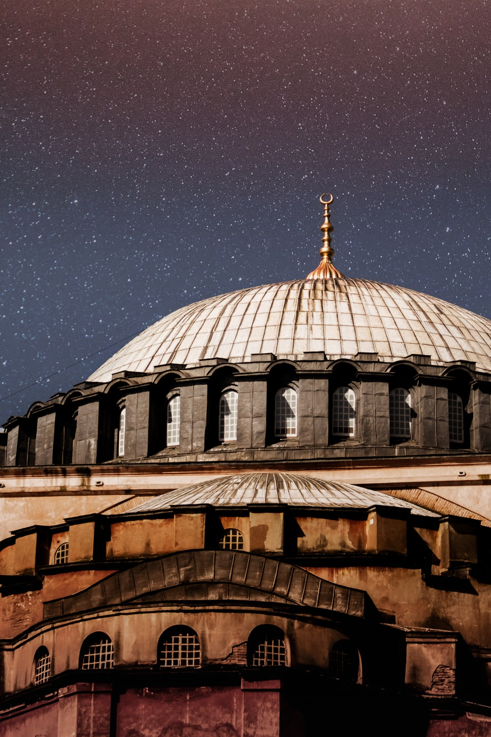 white and brown domed building under starry sky