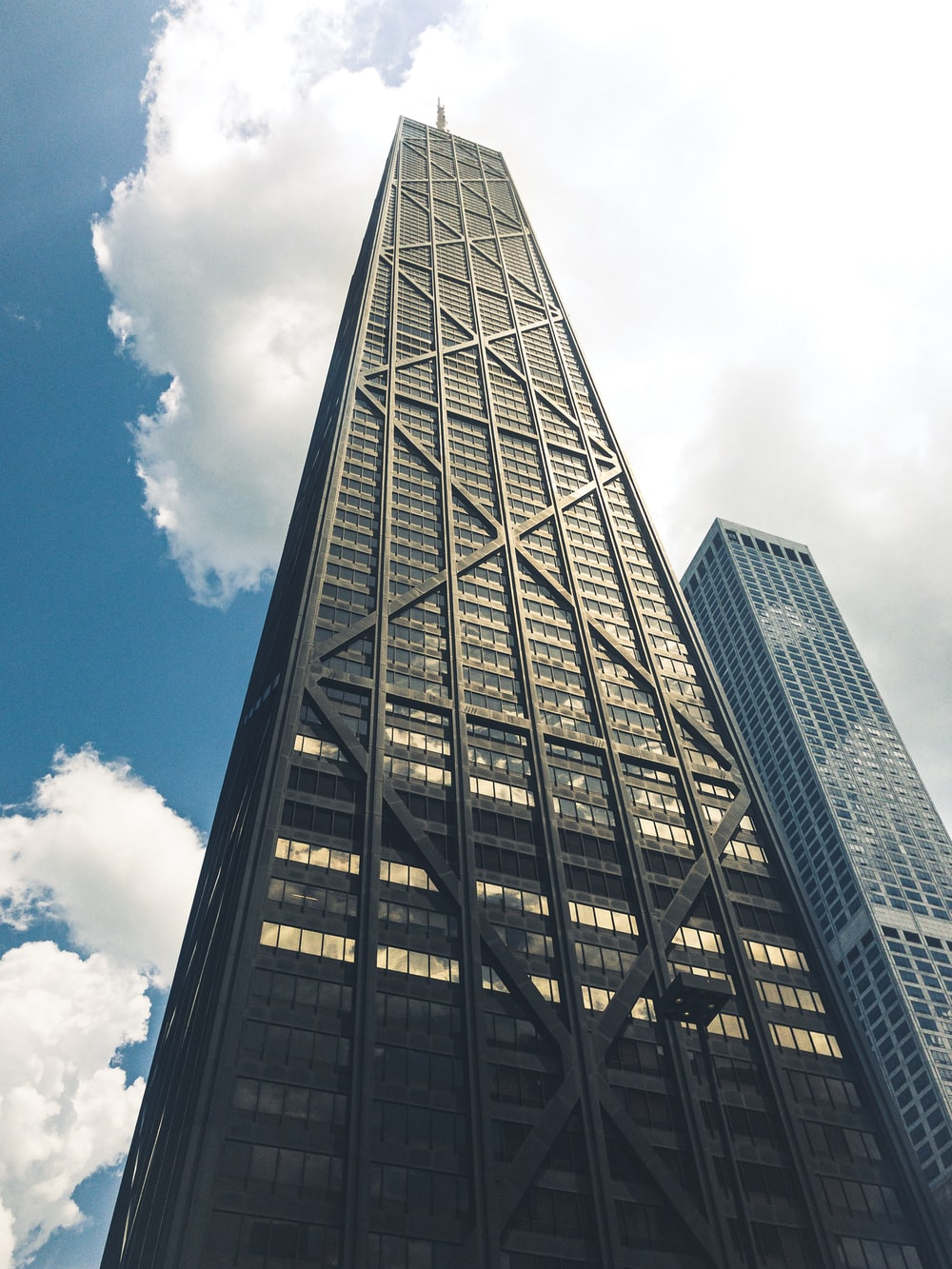 low-angle photography of building under clear blue sky