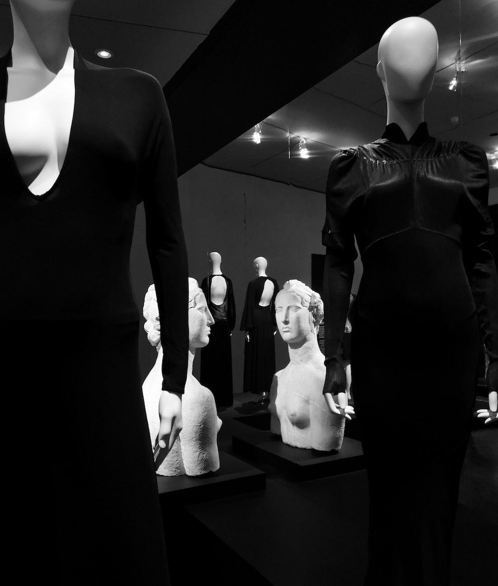 black v-neck long-sleeved dress close-up photography