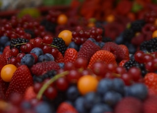 bunch of raspberry and grapes