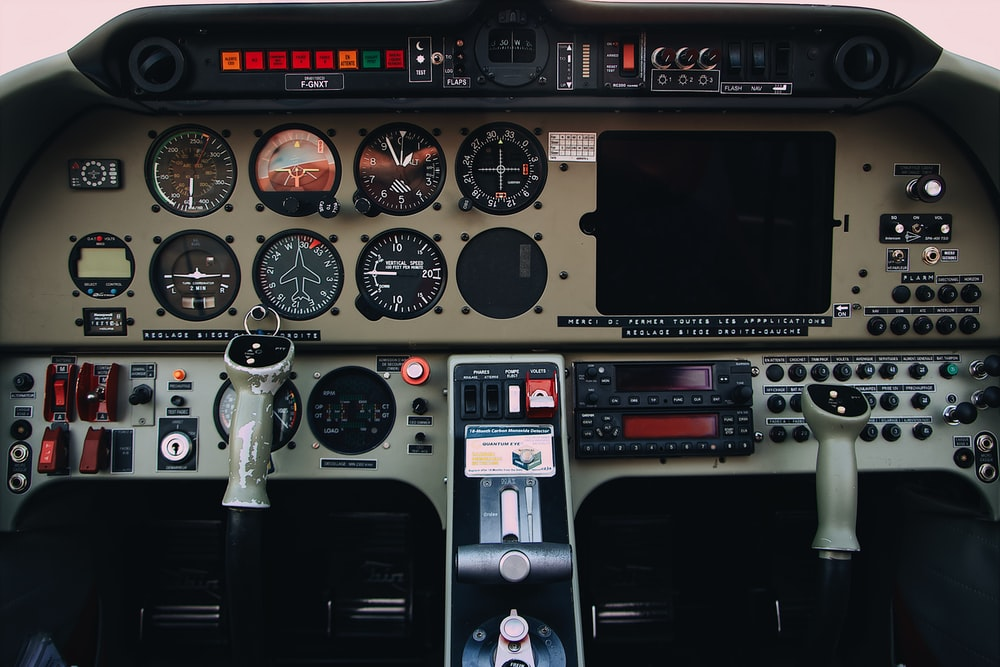 gray and black airplane control panels