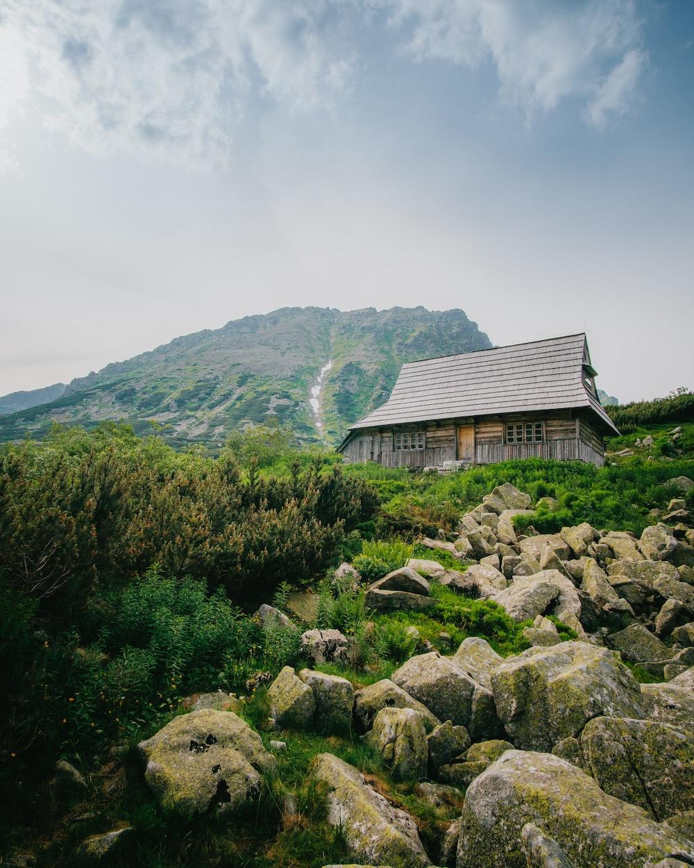 barn house beside mountain and rocks