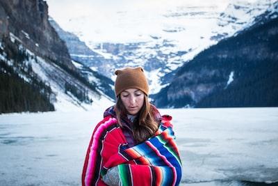 woman wearing brown knit cap toboggan zoom background