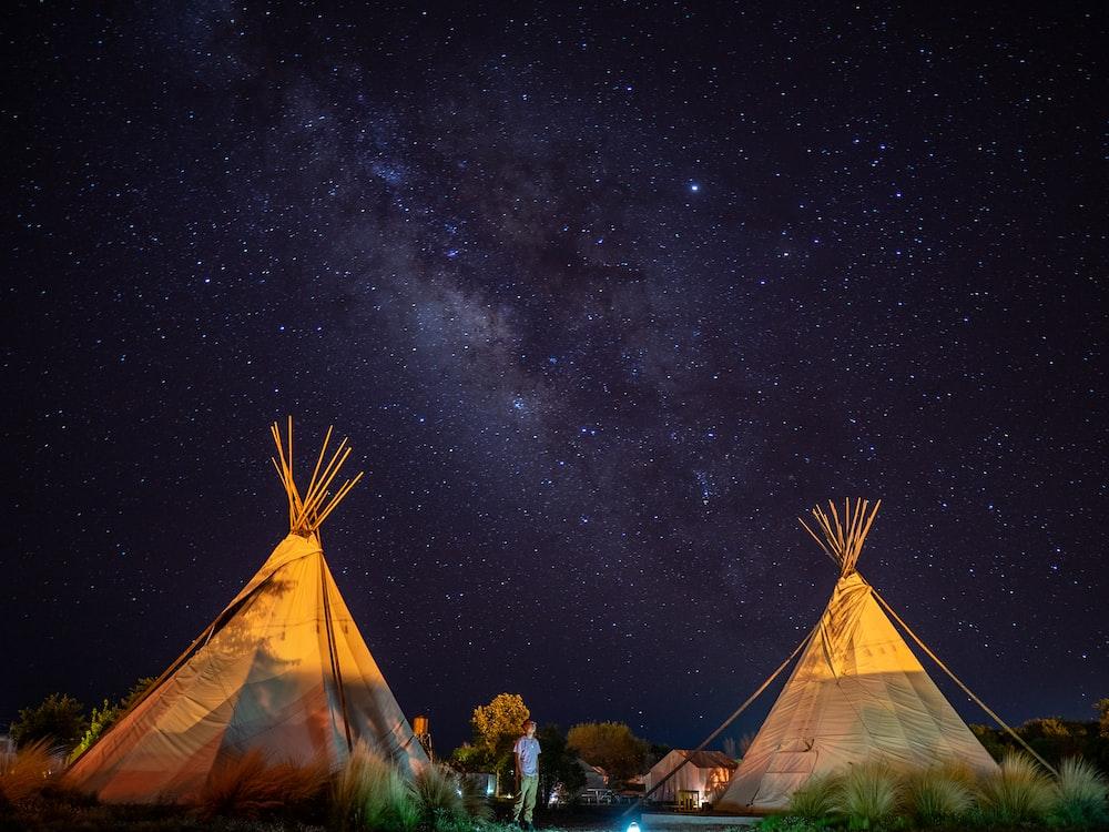 two brown tiki tents