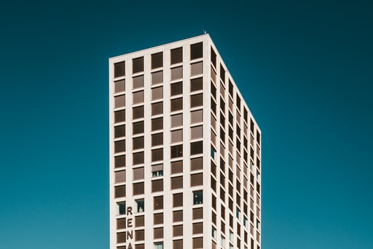 white concrete high-rise building during daytime