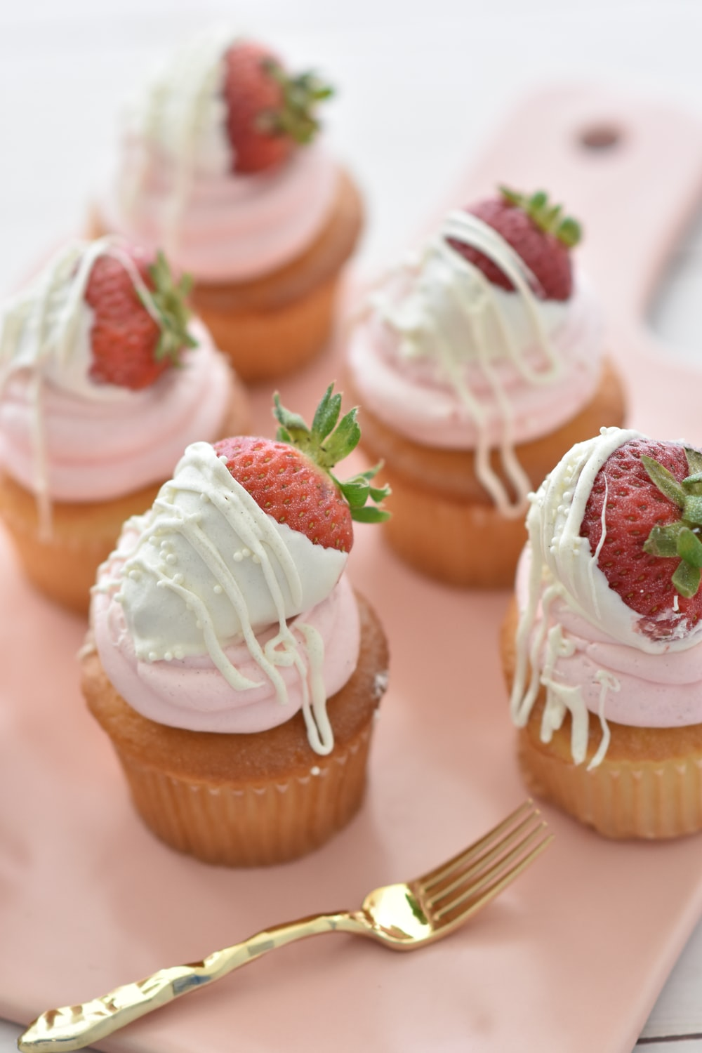 selective focus photography of cupcakes with icings