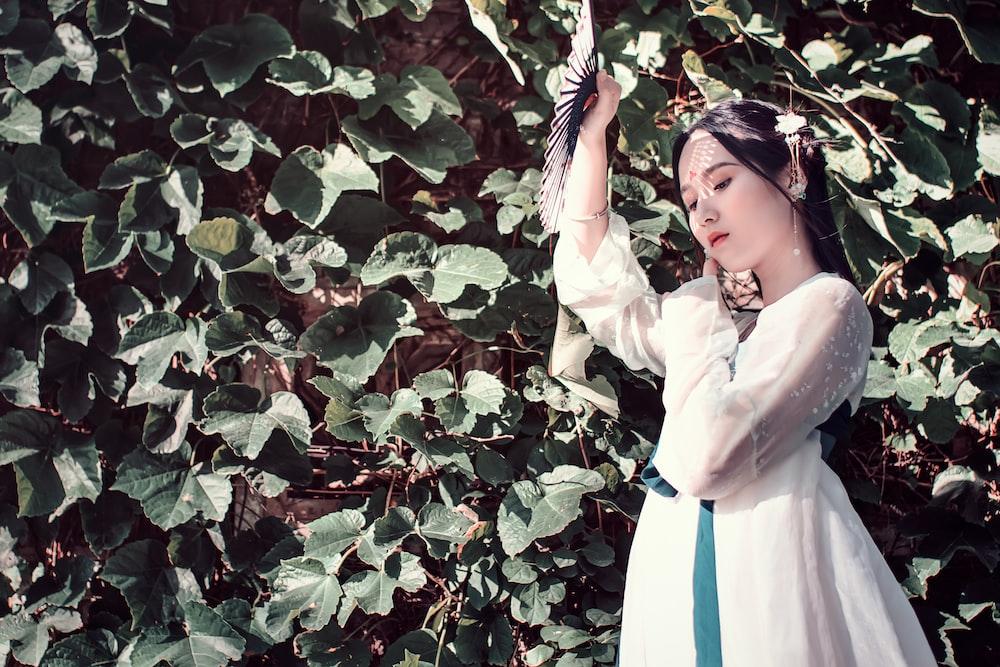 women's white and blue long-sleeved dress