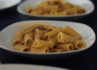 macaroni on white plates photo