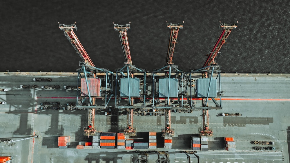 bird's-eye view of freight containers and cranes