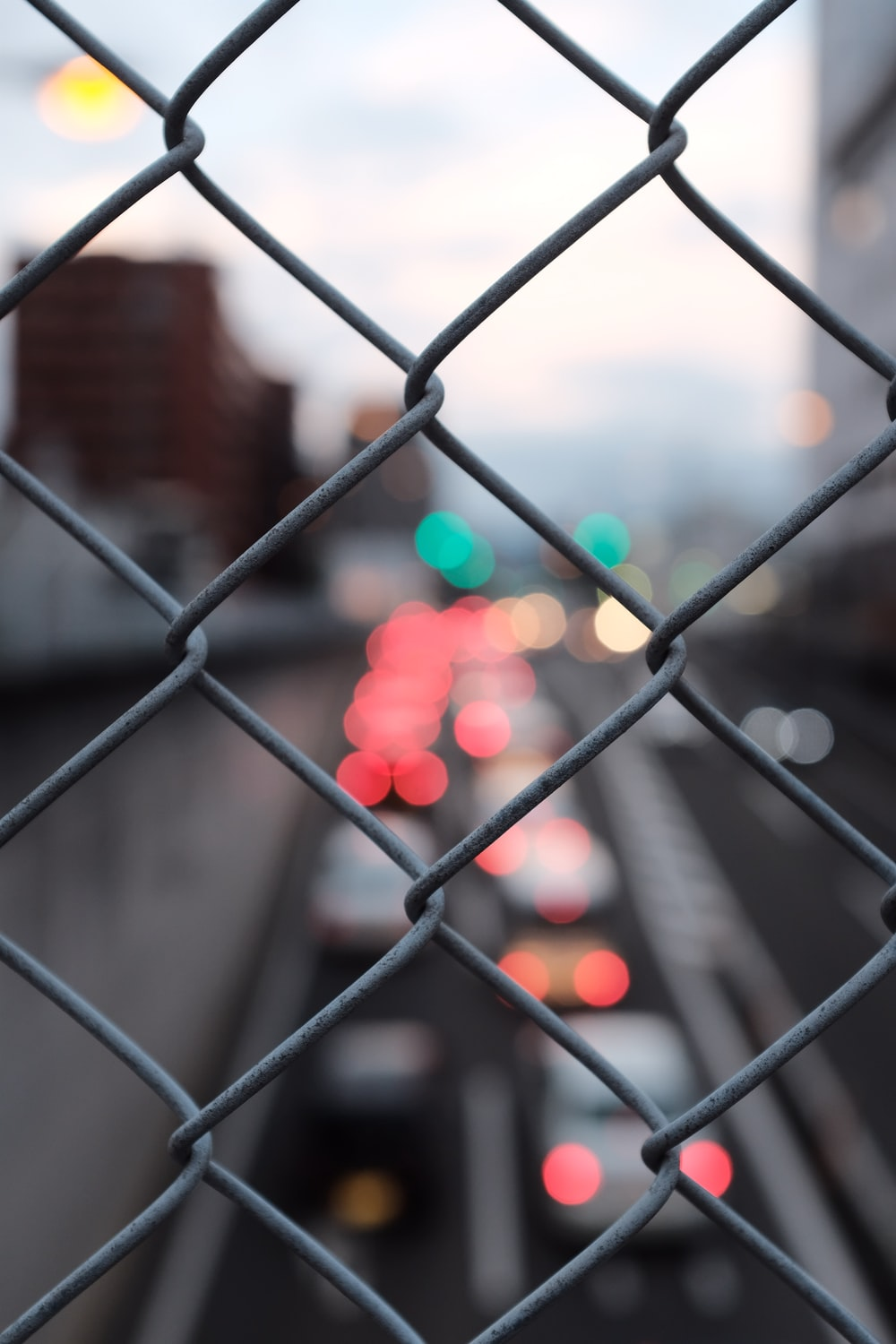 grey chain-link fence bokeh photography