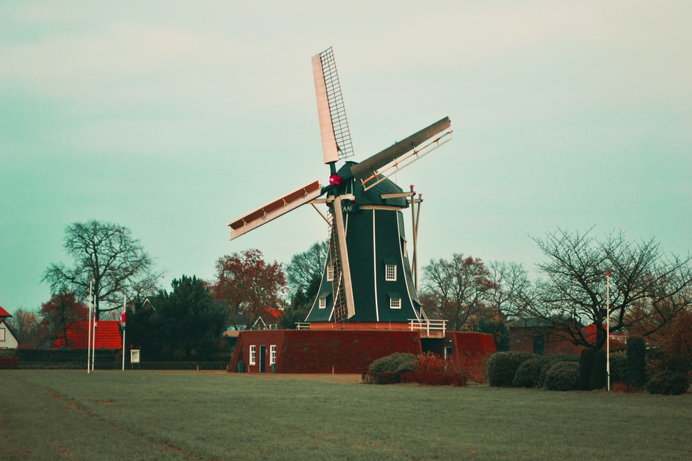 photo of brown and green windmill
