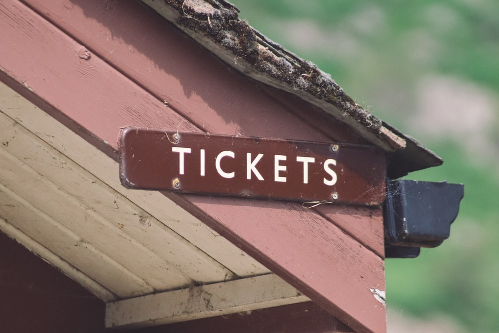 tickets signboard on wooden surface