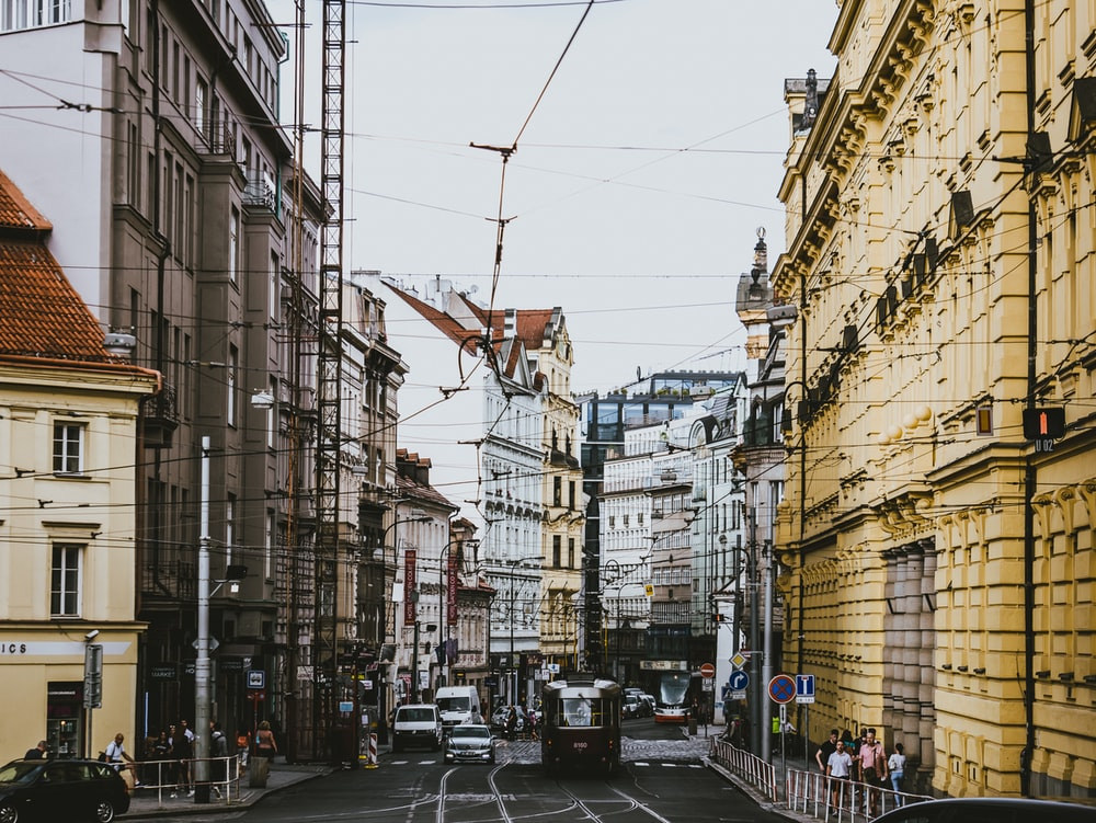 vehicle passing beside buildings