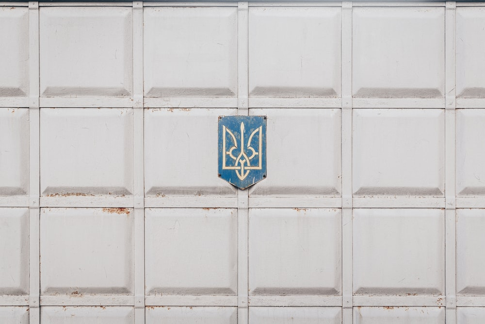 blue and white emblem on white wall