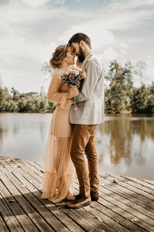 couple standing on dock