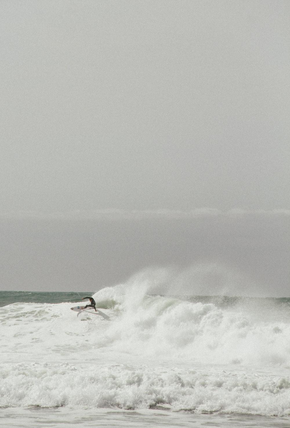 surfing man on huge waves