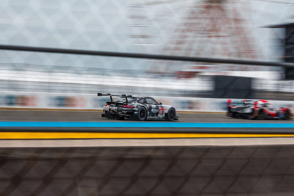 panning photography of racing cars