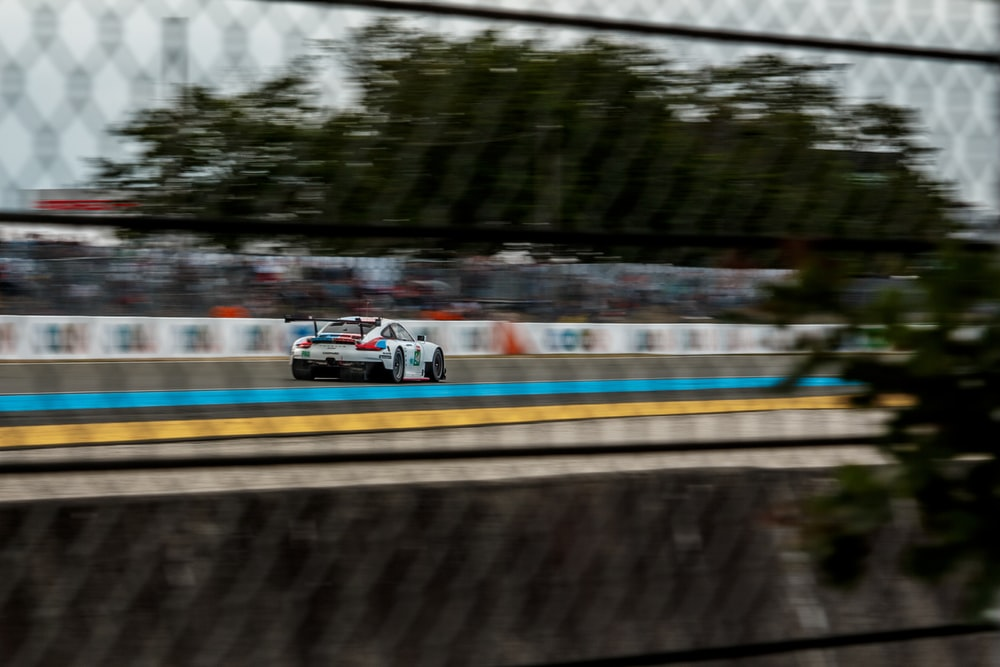 selective focus photography of white sport car