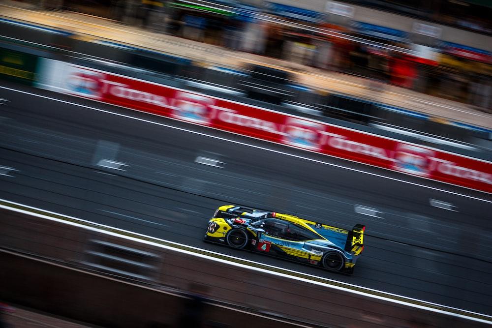 panning photography of racing car