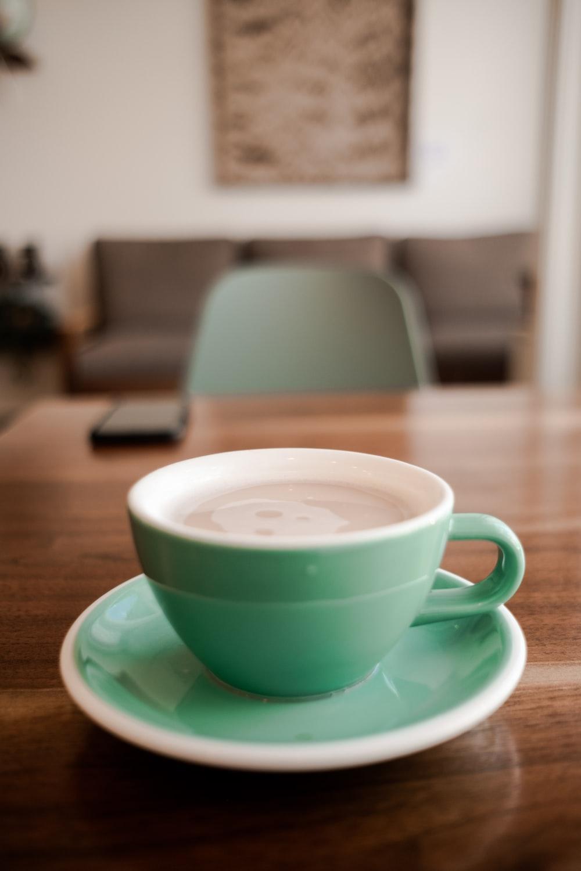 teal ceramic cup and saucer