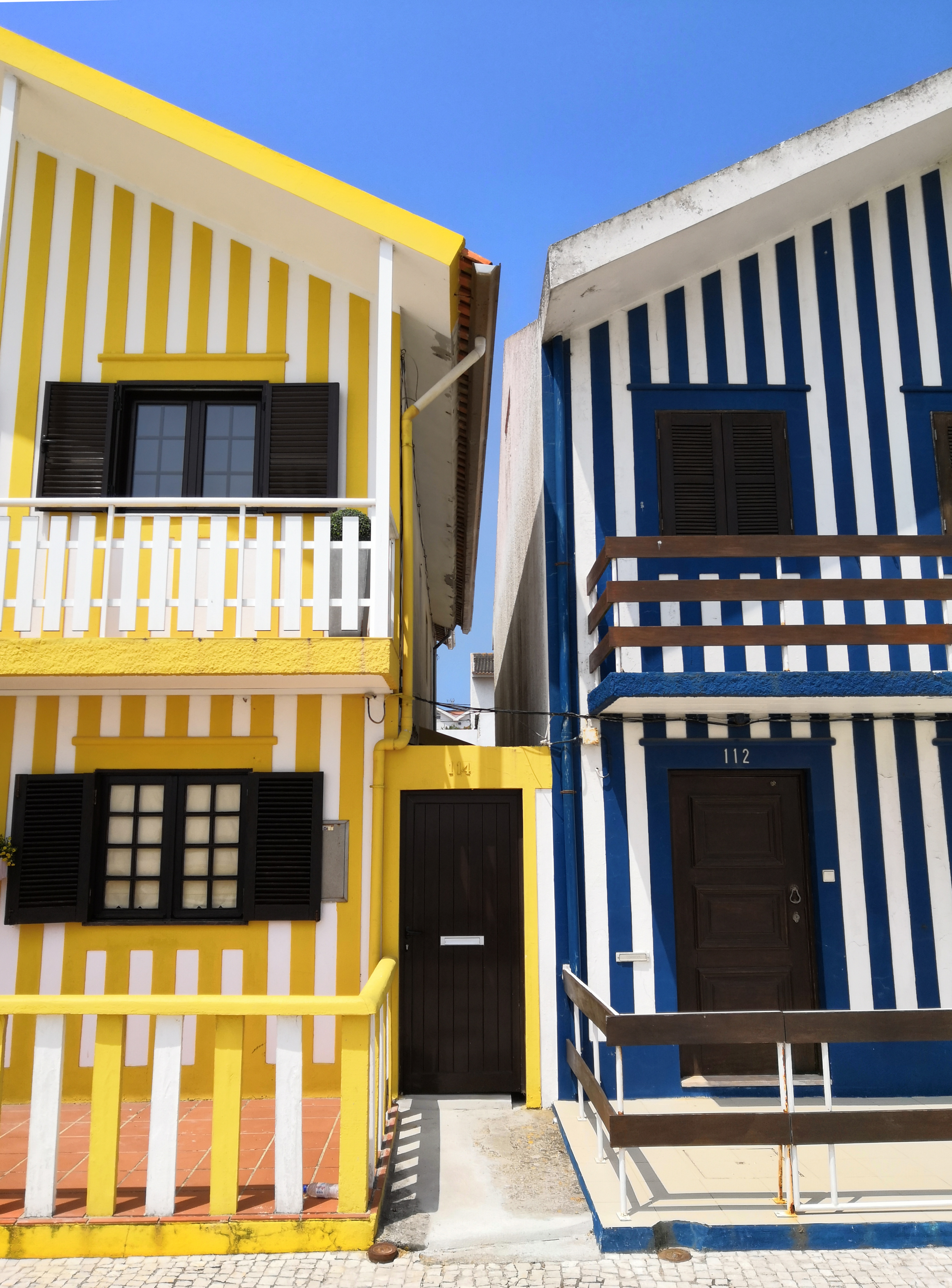 yellow and blue houses showing closed door