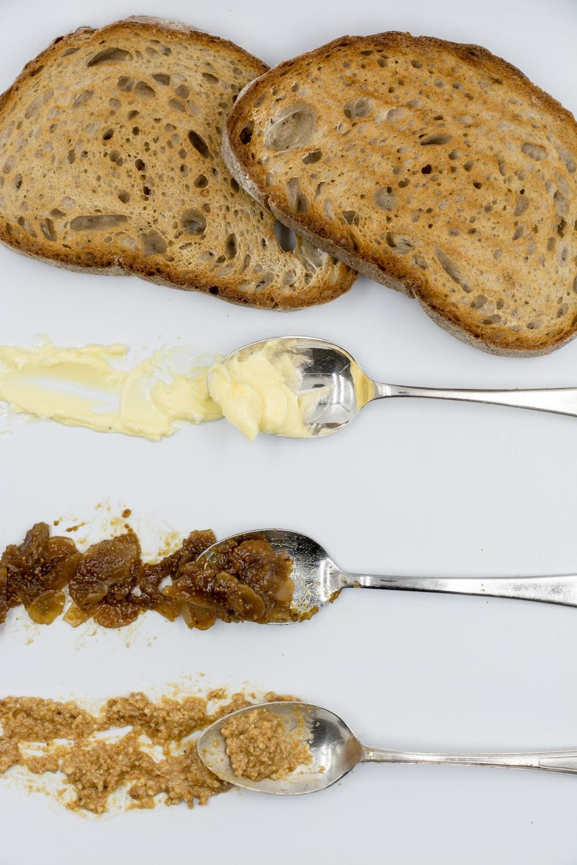 brown bread beside three spoons