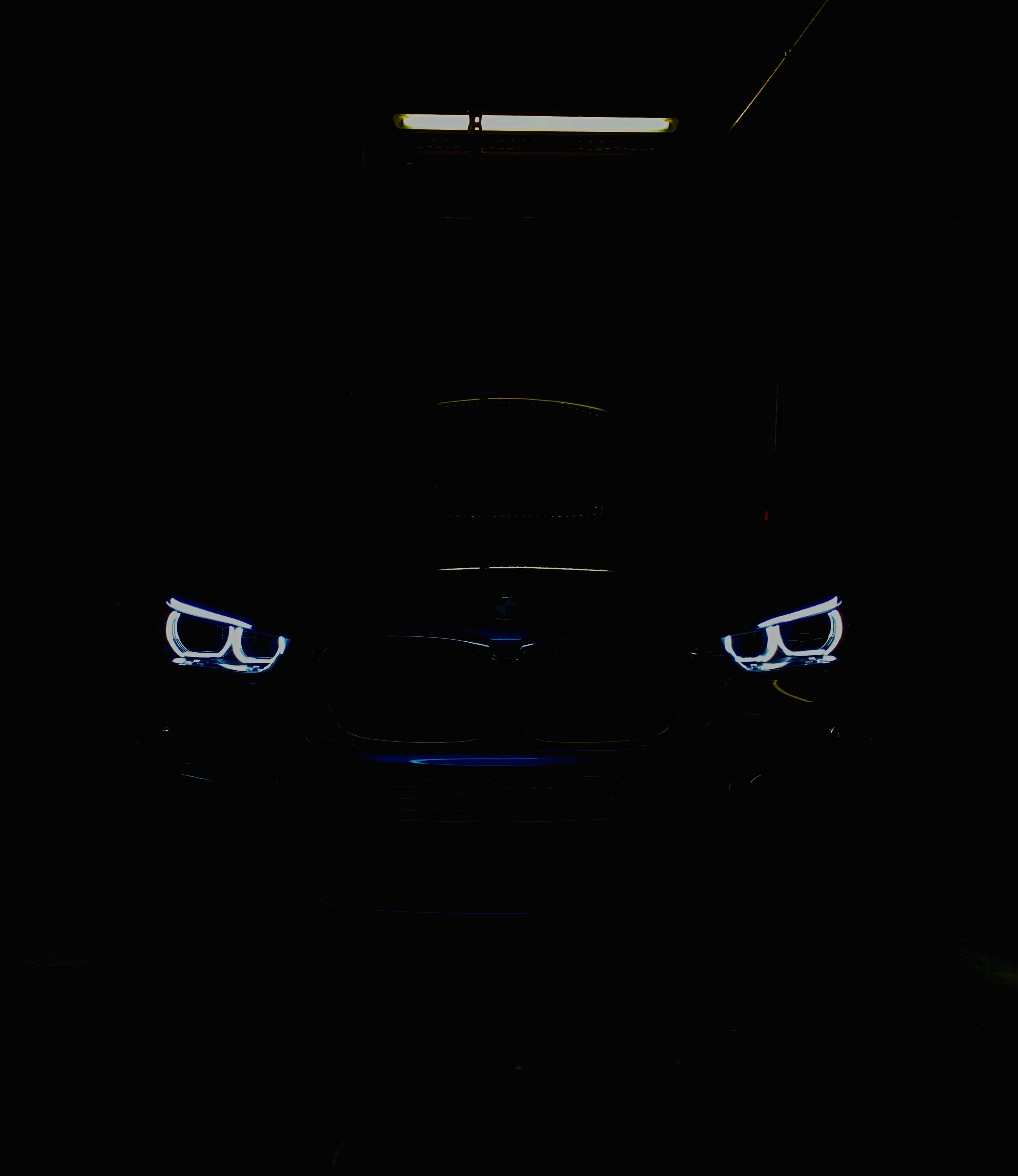 Black Car In The Dark With Lighted Daytime Running Lights Photo Free Logo Image On Unsplash
