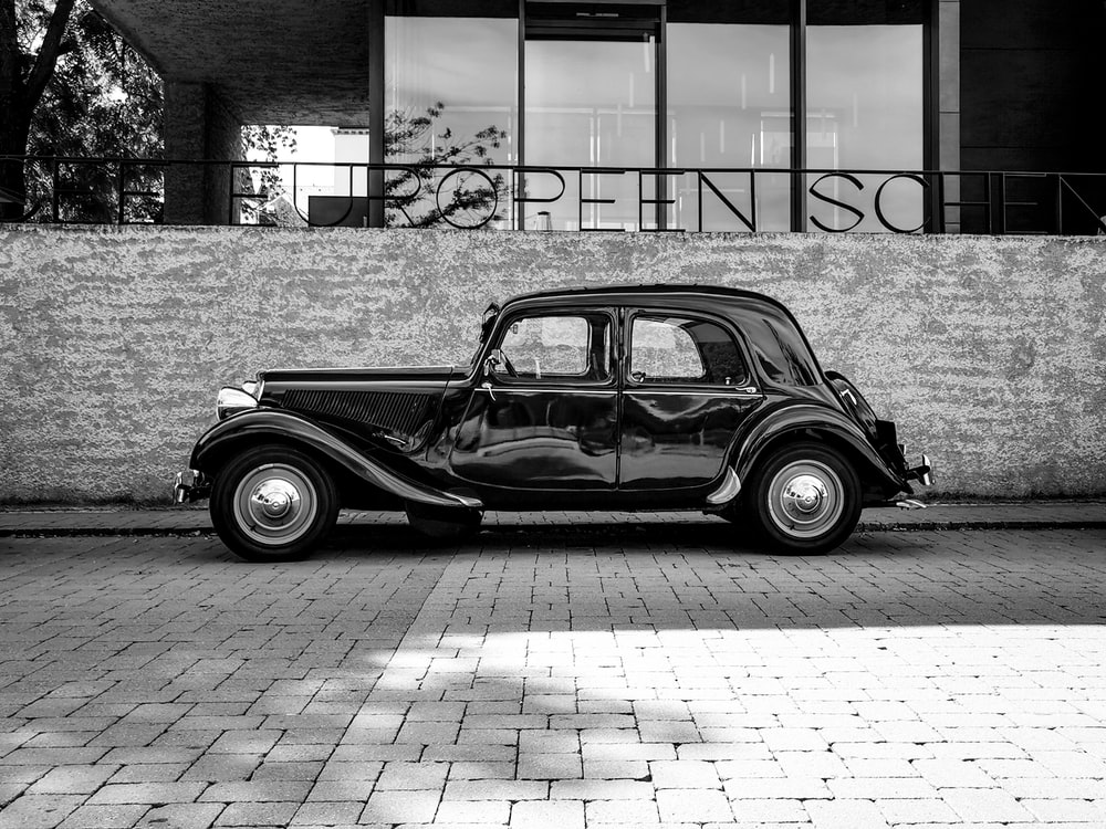 grayscale photography of vehicle