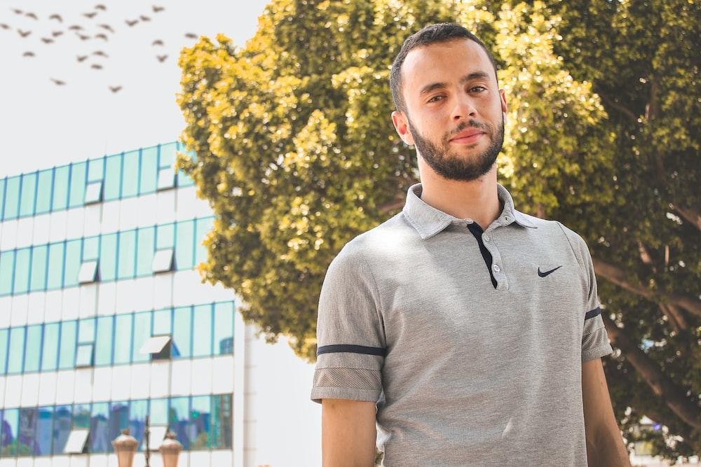 man wearing gray Nike collared t-shirt