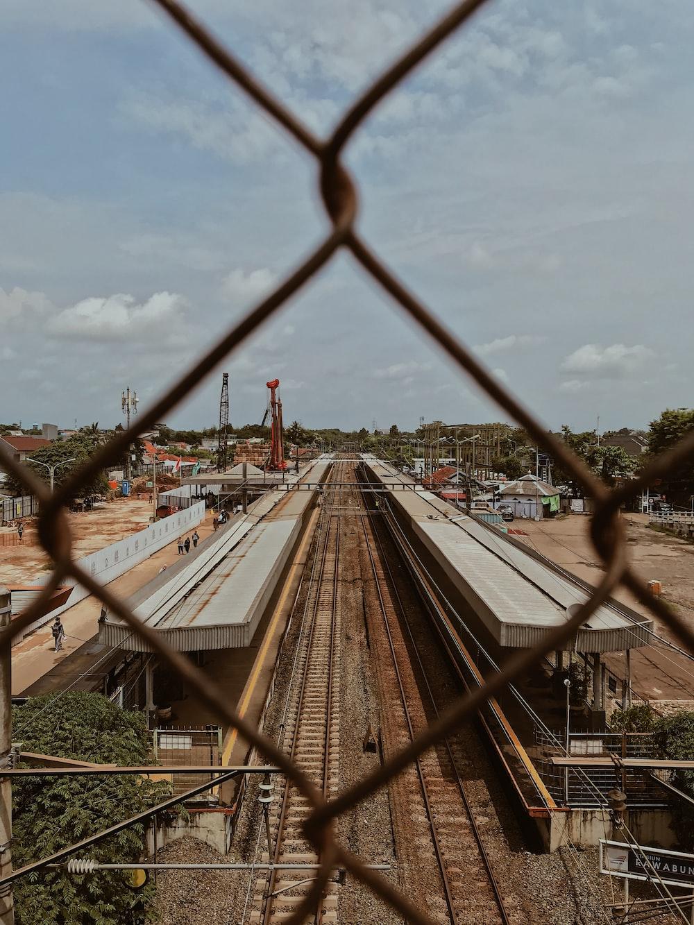 brown railway under clear blue sky